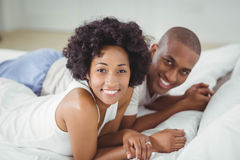 Smiling couple lying on the bed Stock Photo
