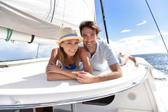 Smiling couple lying on a deck of sailing boat Royalty Free Stock Image