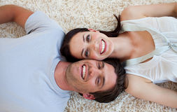 Smiling Couple lying on the floor Royalty Free Stock Images