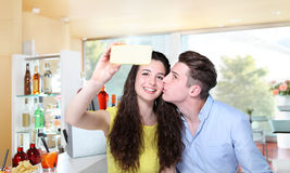 Smiling couple make a selfie in bar Stock Photos