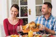 Smiling couple while man holding rast turkey Stock Photography