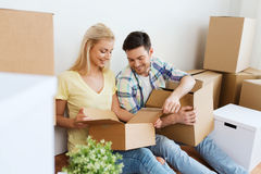 Smiling couple with many boxes moving to new home Royalty Free Stock Photography