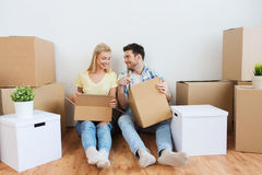 Smiling couple with many boxes moving to new home Royalty Free Stock Photo