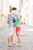 Smiling couple with map and photo camera in city Royalty Free Stock Photography