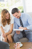 Smiling couple in meeting with a financial adviser Royalty Free Stock Photography