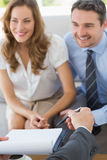 Smiling couple in meeting with a financial adviser Stock Image