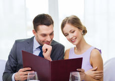 Smiling couple with menu at restaurant Royalty Free Stock Image