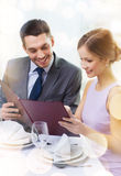Smiling couple with menu at restaurant Royalty Free Stock Photography
