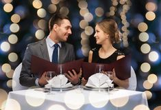 Smiling couple with menus at restaurant Stock Photos