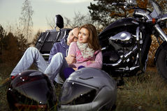 Smiling couple on motorcycle Royalty Free Stock Images