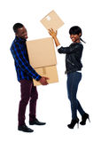 Smiling couple moving cardboard boxes Royalty Free Stock Images