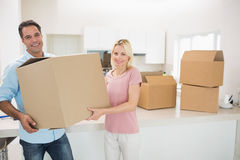 Smiling couple moving together in a new house Stock Photography