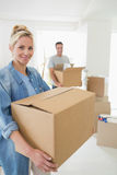 Smiling couple moving together in a new house Royalty Free Stock Photography