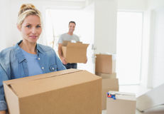 Smiling couple moving together in a new house Stock Image
