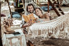 Smiling Couple Of Hippies Relaxing In Park Stock Images