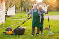 Smiling couple of old gardeners. Royalty Free Stock Images