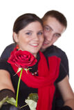Smiling couple and one red rose Royalty Free Stock Photography