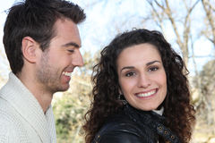 Smiling couple outdoors Royalty Free Stock Photo