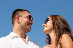 Smiling couple over blue sky background Royalty Free Stock Images