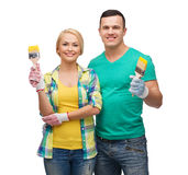 Smiling couple with paintbrush Royalty Free Stock Photo