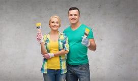 Smiling couple with paintbrush Royalty Free Stock Photo