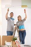 Smiling couple painting ceiling Royalty Free Stock Photography