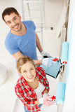 Smiling couple painting wall at home Royalty Free Stock Photos