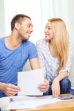 Smiling couple with papers and calculator at home Royalty Free Stock Photo