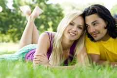 Smiling couple at park Royalty Free Stock Photo