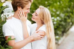 Smiling couple in park royalty free stock images