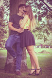 Smiling couple in park Stock Photos