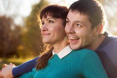 Smiling couple in Park at sunshine weather Stock Photography
