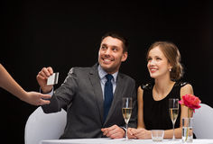 Smiling couple paying for dinner with credit card Stock Photos