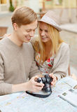 Smiling couple with photo camera Royalty Free Stock Image