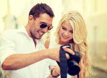 Smiling couple with photo camera Royalty Free Stock Images