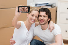 Smiling couple photographing themselves Stock Photos