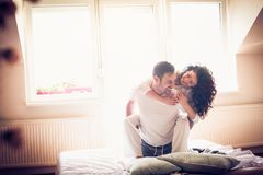 Cheerfully morning in bed. Space for copy. Smiling couple playing on bed. Valentines day. Space for copy Royalty Free Stock Image