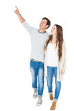 Smiling couple pointing away Stock Image