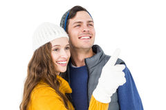 Smiling couple pointing and looking away Royalty Free Stock Photography