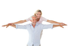 Smiling couple posing with arms out Royalty Free Stock Images