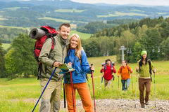 Posing hiker couple with landscape background Royalty Free Stock Images