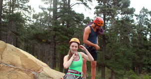 Smiling couple preparing themselves to rock climb stock video footage