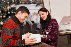 Smiling Couple with Presents Near Christmas Tree royalty free stock images
