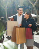Smiling couple with purchases Royalty Free Stock Images