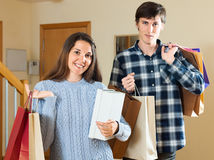 Smiling couple with purchases. Smiling couple with  purchases in house entrance Royalty Free Stock Images