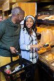 Smiling couple purchasing bread Royalty Free Stock Photos