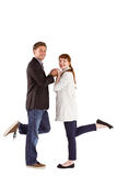 Smiling couple with raised legs Royalty Free Stock Image