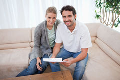 Smiling couple reading a letter Stock Photography