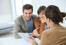 Smiling couple ready to buy a house Stock Photography