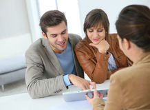 Smiling couple ready to buy a house Stock Photos